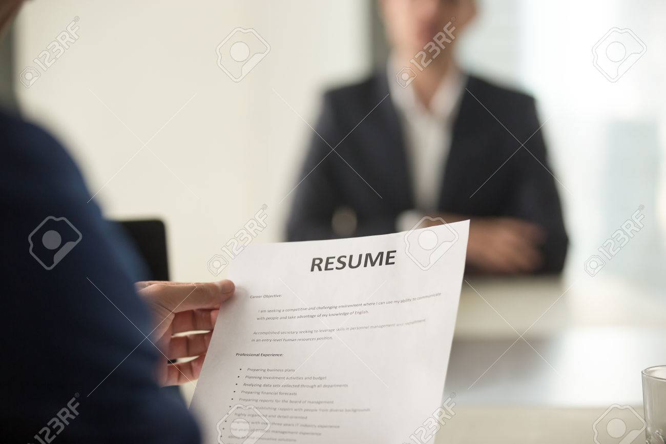 Close Up View Of Job Interview In Office Focus On Resume Writing