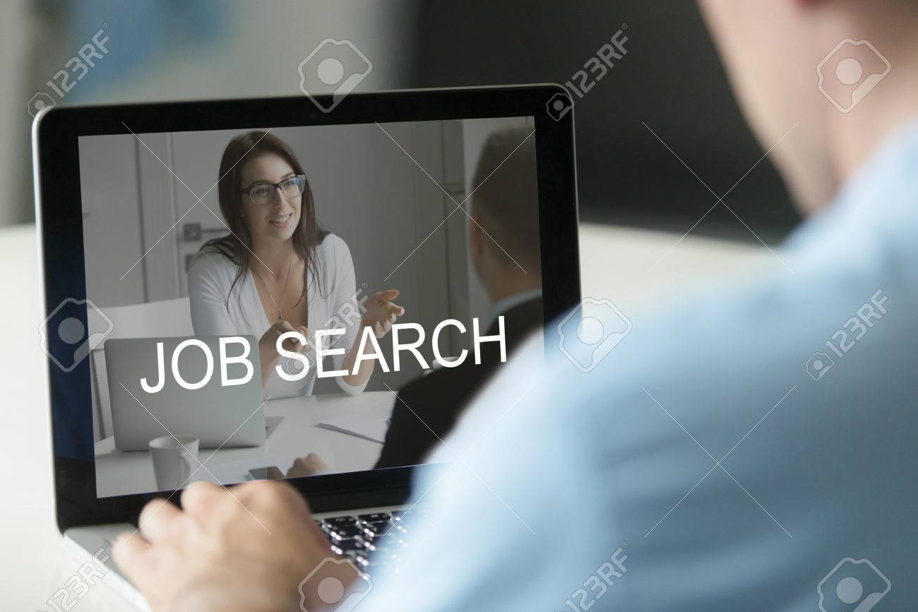 Unemployed Man Using Computer Searching Work Online Applying