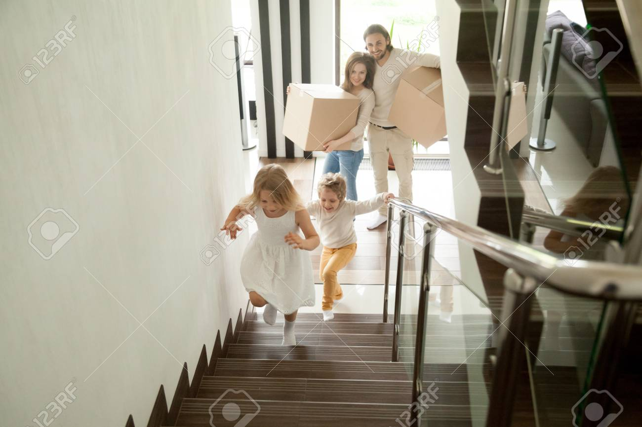 Happy Children Going Upstairs Inside Two Story Big House Excited Kids Having Fun Stepping Walking