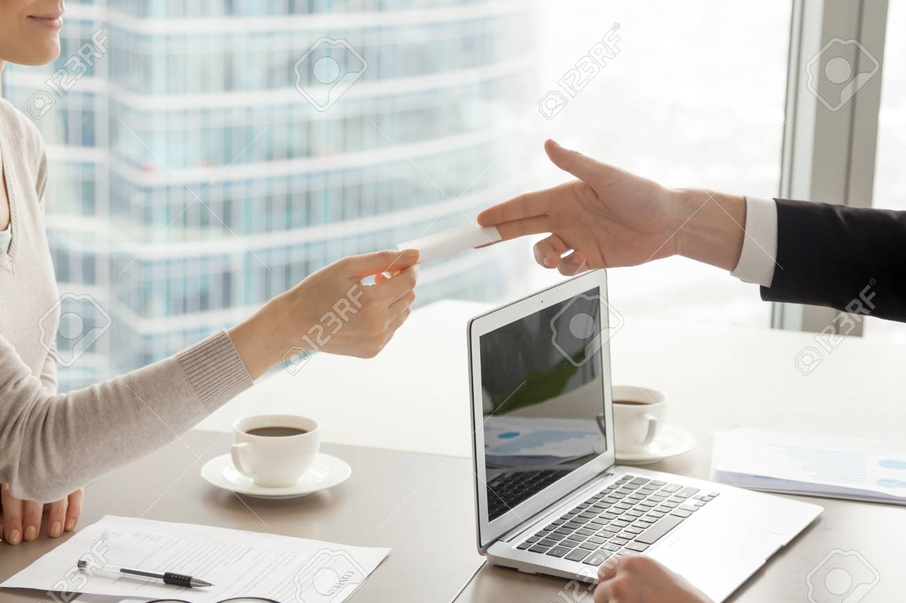 Businessman Stretching Out Hand With Blank Business Card Over Desk ...