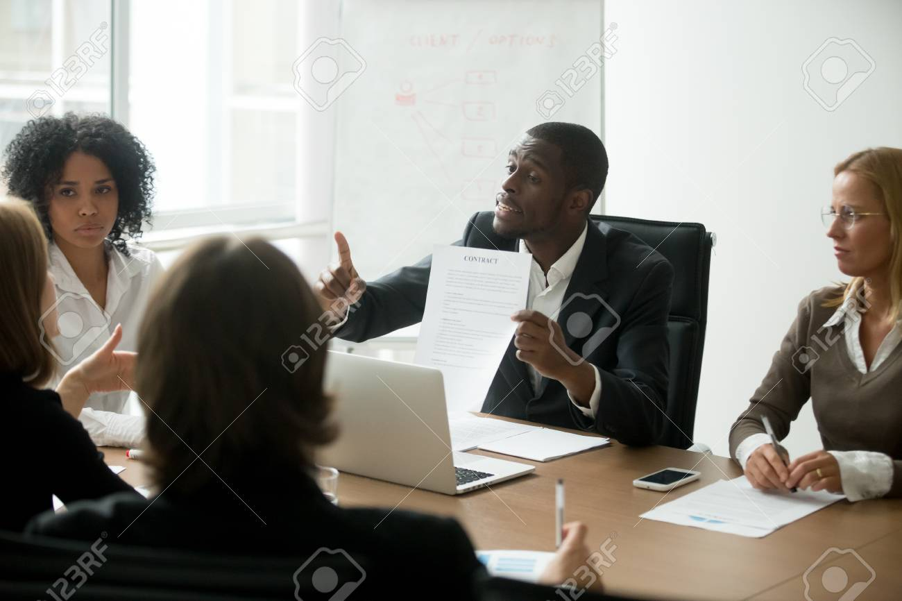 African american businessman disagreeing with contract terms at group multi-ethnic negotiations, black partner arguing about deal conditions or fraud scam pointing at document at multiracial meeting - 97052269