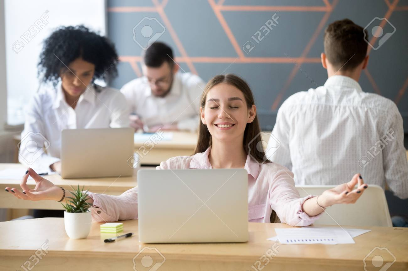 Calm Smiling Woman Practicing Office Meditation In Coworking Space Taking  Break For Relaxation, Mindful Happy