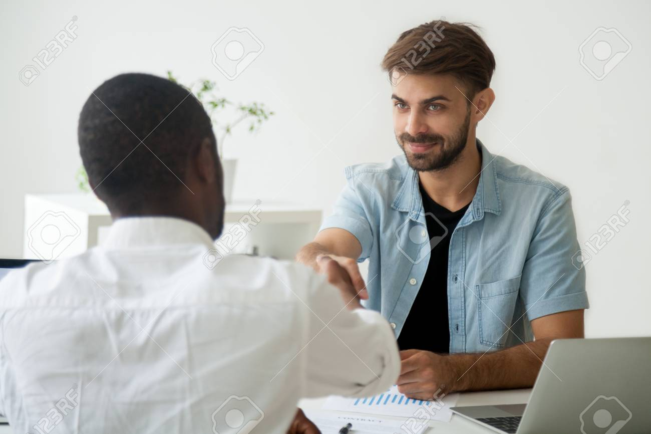 Friendly Caucasian Employer Greeting African American Job Candidate