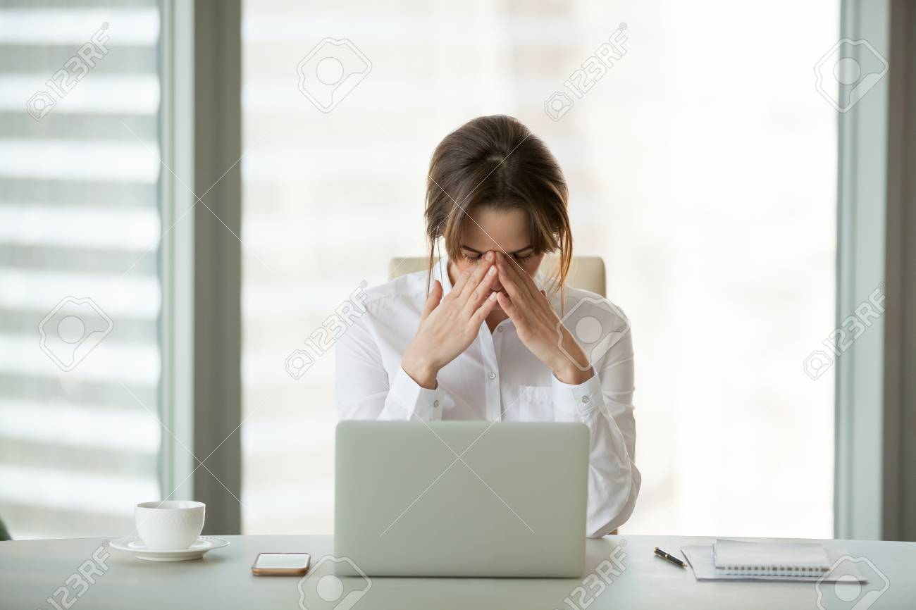 Frustrated businesswoman feels panic shock after business failure or bad news online sitting in office with laptop, stressed upset woman employee worried about bankruptcy, exhausted tired of overwork - 107343971