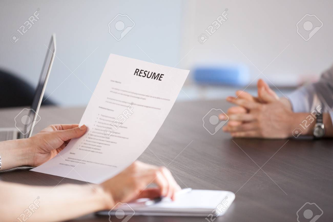 Hands Of Hr Holding Paper Resume At Job Interview Recruiter Stock
