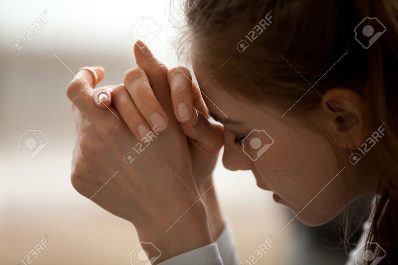 Close up of upset woman feel down and sad having life or relationships trouble, frustrated female with eyes closed in despair think of problem solution, hurt girl heartbroken after breakup or bad news - 112484098