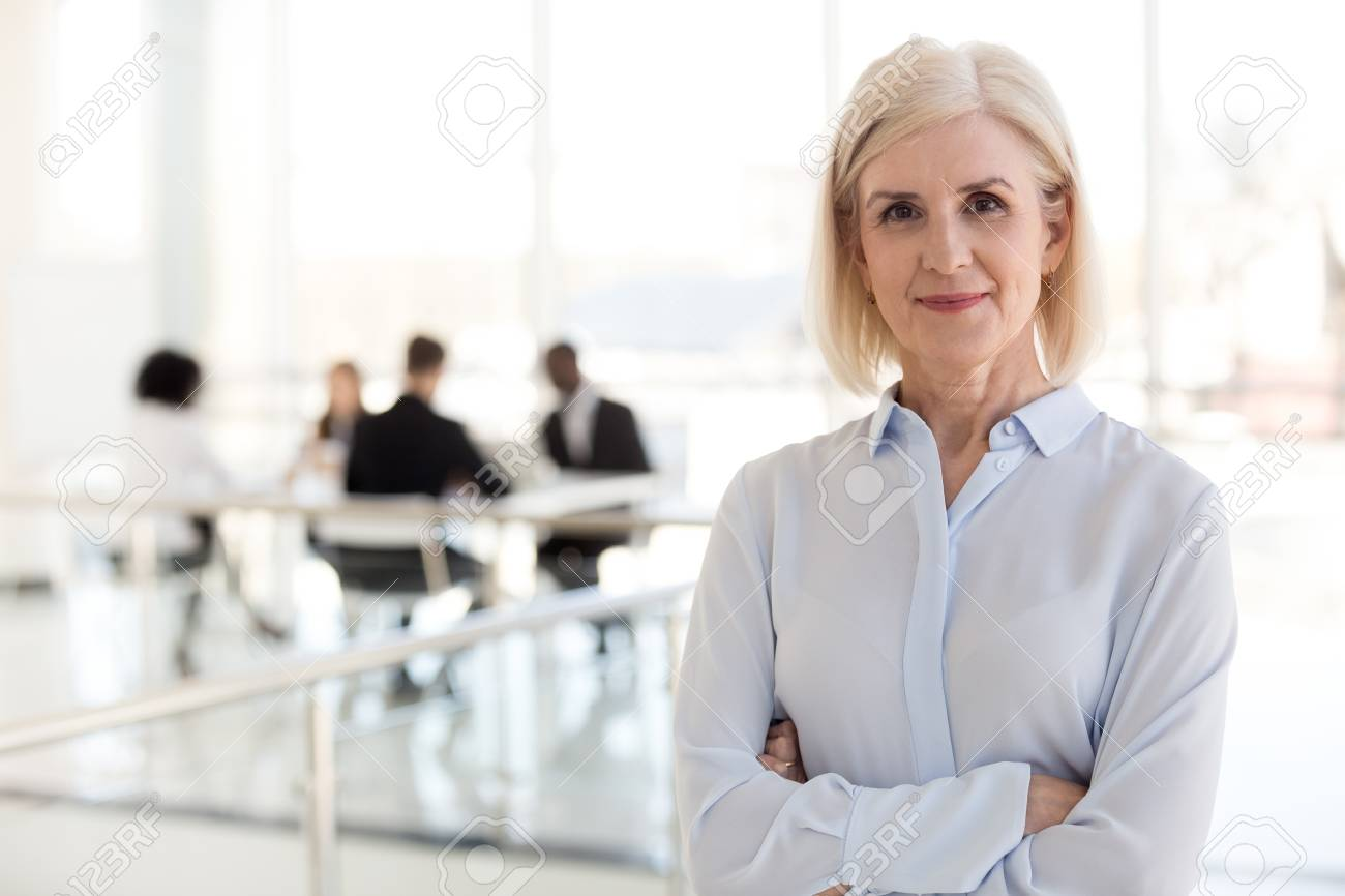 Confident mature businesswoman looking at camera, middle aged company ceo director, experienced senior female professional, old lady business coach team leader posing in office, headshot portrait - 112485480