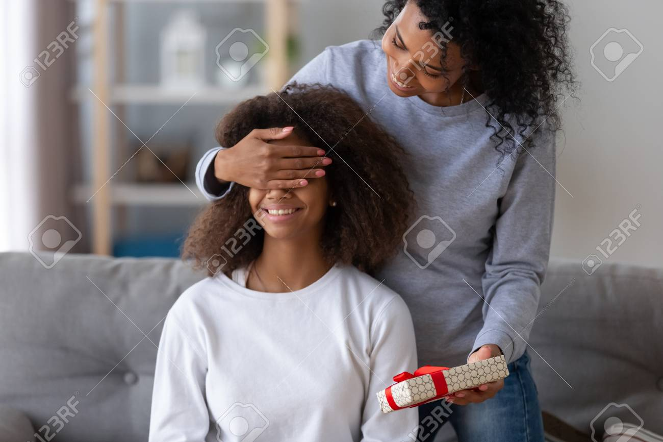 Excited Black Young Mom Make Surprise For Teenage Daughter Happy African American Mother Close Child