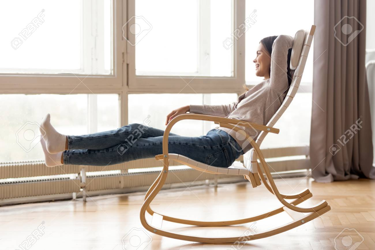 Picture of: Smiling Woman Relaxing In Comfortable Rocking Chair At Home Stock Photo Picture And Royalty Free Image Image 118053946
