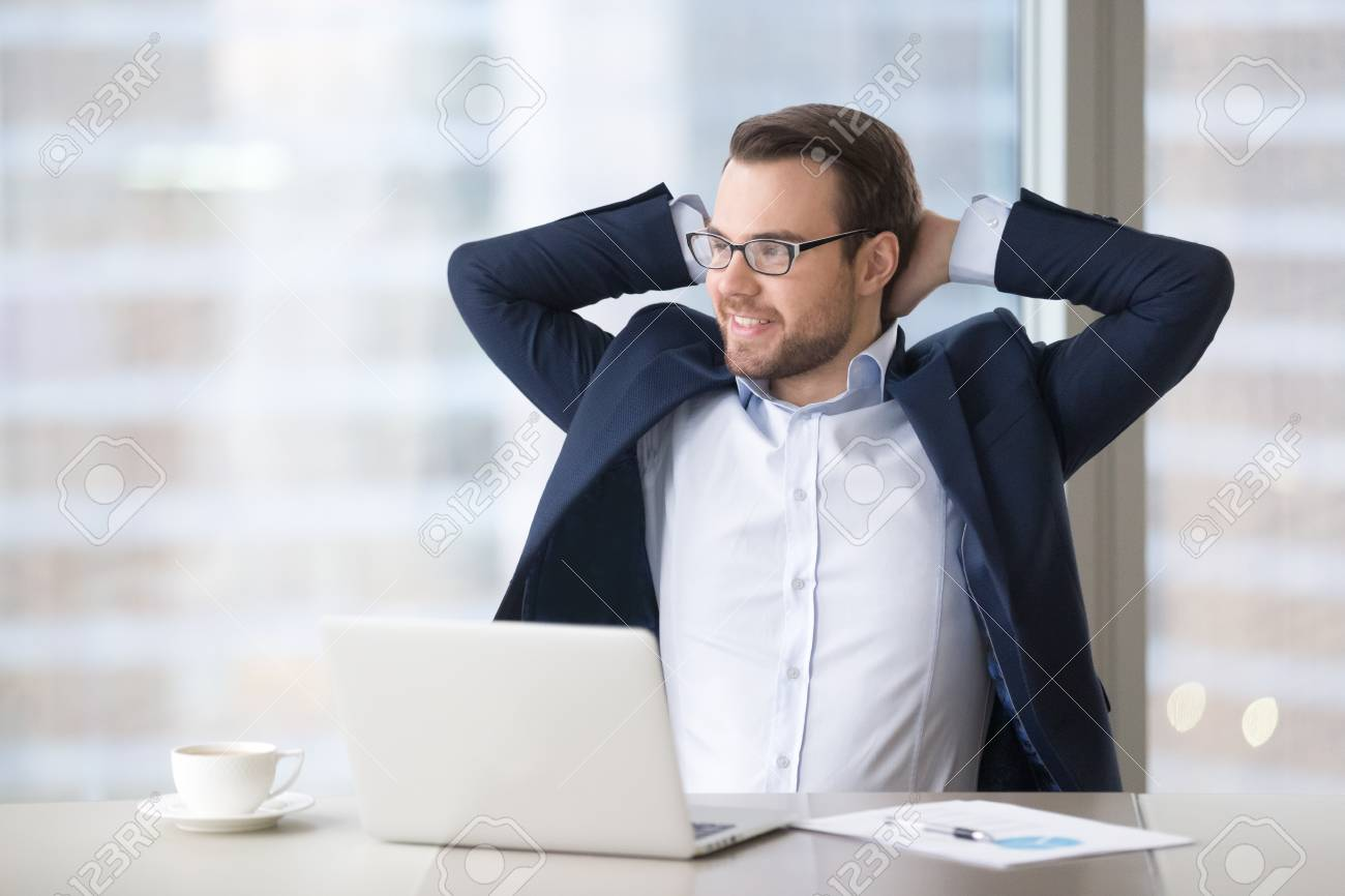 Satisfied Successful Businessman Taking Break At Workplace To Stock Photo Picture And Royalty Free Image Image 118204262