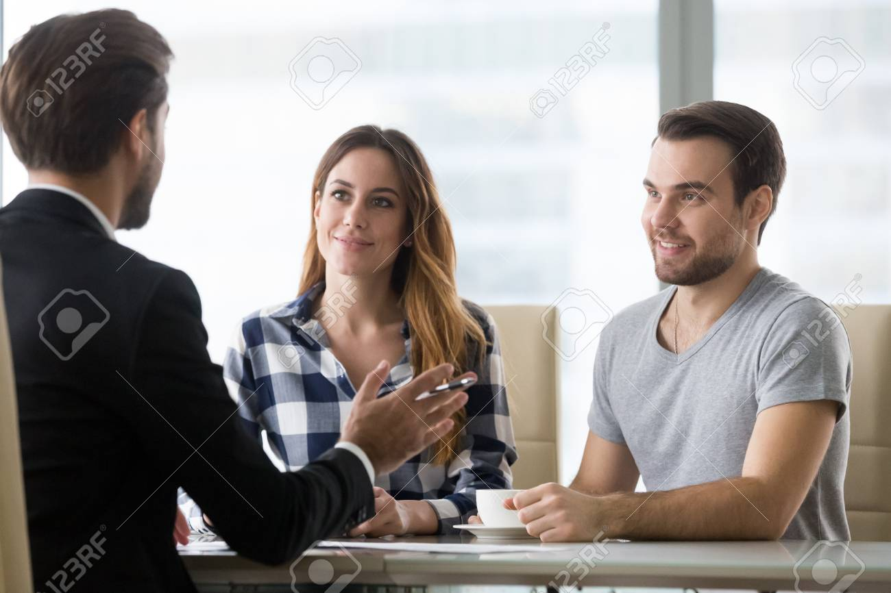 Couple customers consulting lawyer or about buying house or insurance services, salesman, bank worker or financial advisor making presentation offer to clients at meeting in office - 118204280
