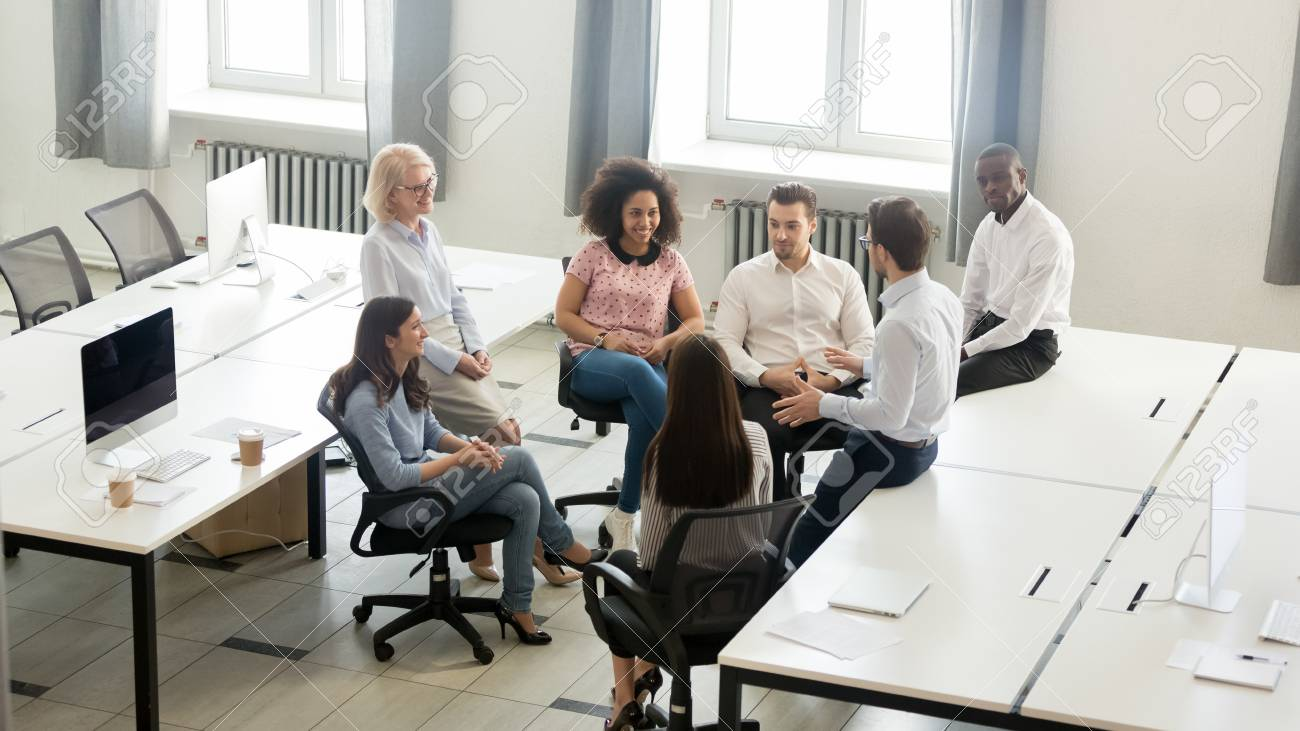 Male manager coach mentor speaking at corporate group business meeting, team leader talking to workers training interns at workshop explaining new project strategy in office, top view overhead above - 120519812
