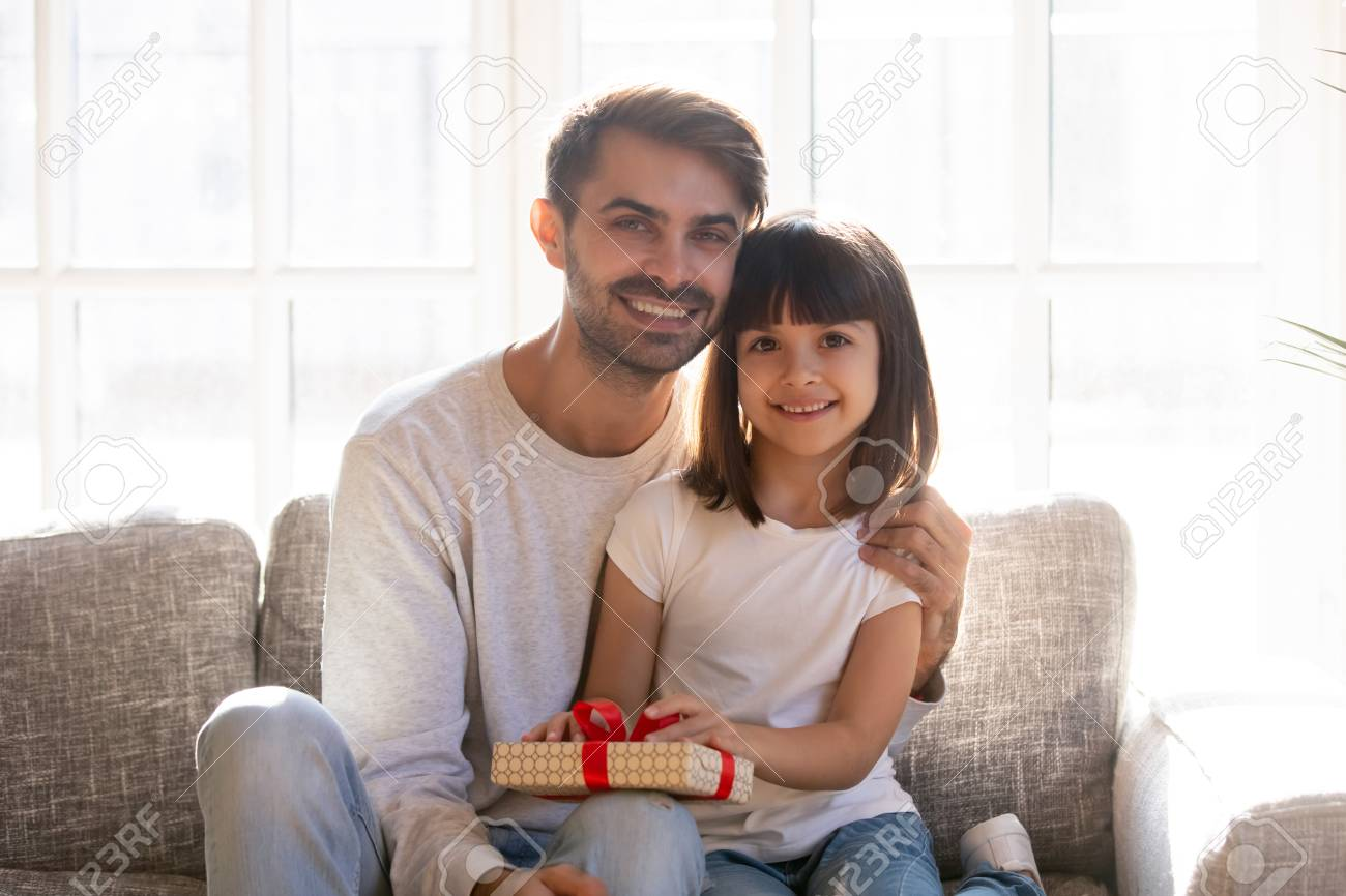 Excellent Smiling Father Small Adorable Daughter Sitting On Couch In Living Alphanode Cool Chair Designs And Ideas Alphanodeonline