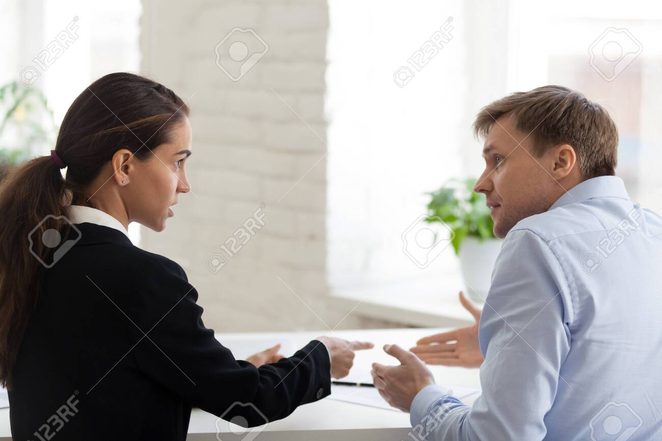 Conflict of female boss and male office worker. Angry bossy business woman shout at irritated man, bad worker. Problem, mistake, stress, depression, overworked, frustrated. People at workplace concept - 121256532
