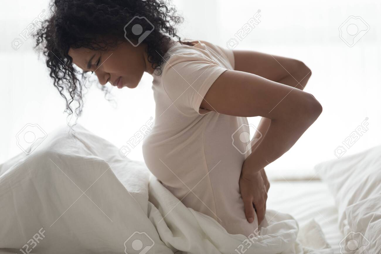 Sad Young African Woman Touching Back Feeling Backache Morning Stock Photo Picture And Royalty Free Image Image 126490020
