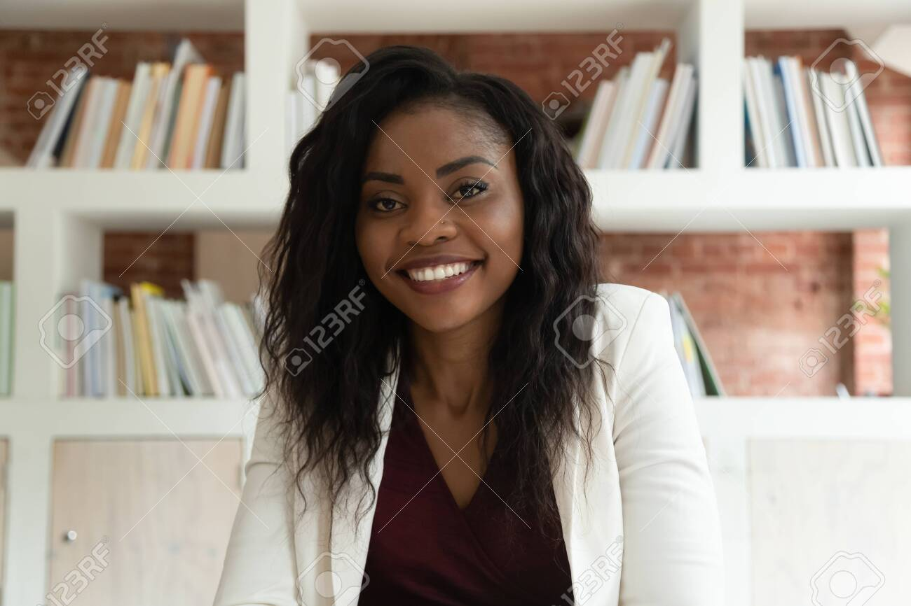 Smiling african american business woman coach teacher hr looking at camera, happy black lady making video call for online job interview by webcamera recording training webinar, webcam view, portrait - 126490146