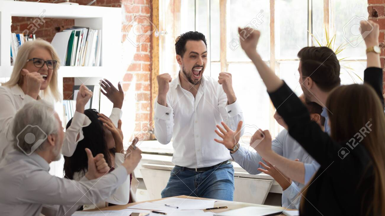 Euphoric excited business team celebrate corporate victory together in office, happy overjoyed professionals group rejoice company victory, teamwork success win triumph concept at conference table - 126490230