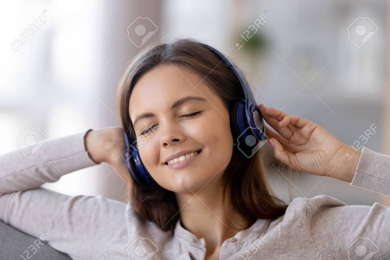 Close Up Of Smiling Female Wear Wireless Headphones Enjoy Favorite Stock Photo Picture And Royalty Free Image Image 135648882