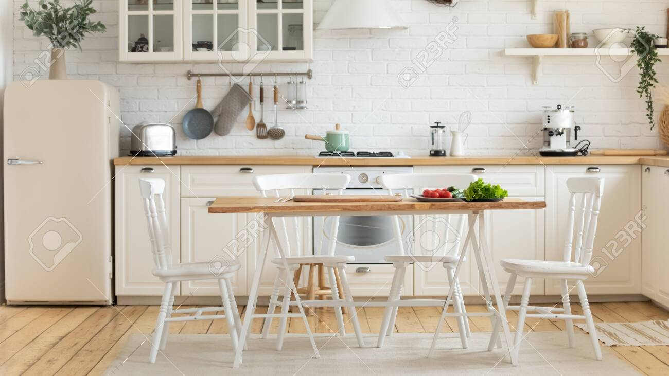 Modern cozy domestic kitchen interior, on dining table fresh vegetables homeowners prefers healthy food, loan mortgage new studio flat for rent, furnishing advertisement, renovation services concept - 136917144
