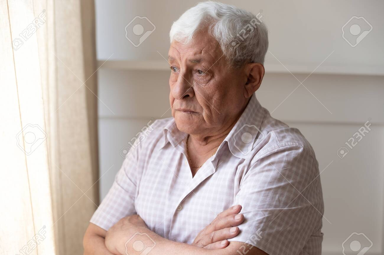 Upset old man look in window distance feel lonely and distressed thinking missing past days, thoughtful upset mature male lost in thoughts mourning yearning, remembering, elderly solitude concept - 139912862