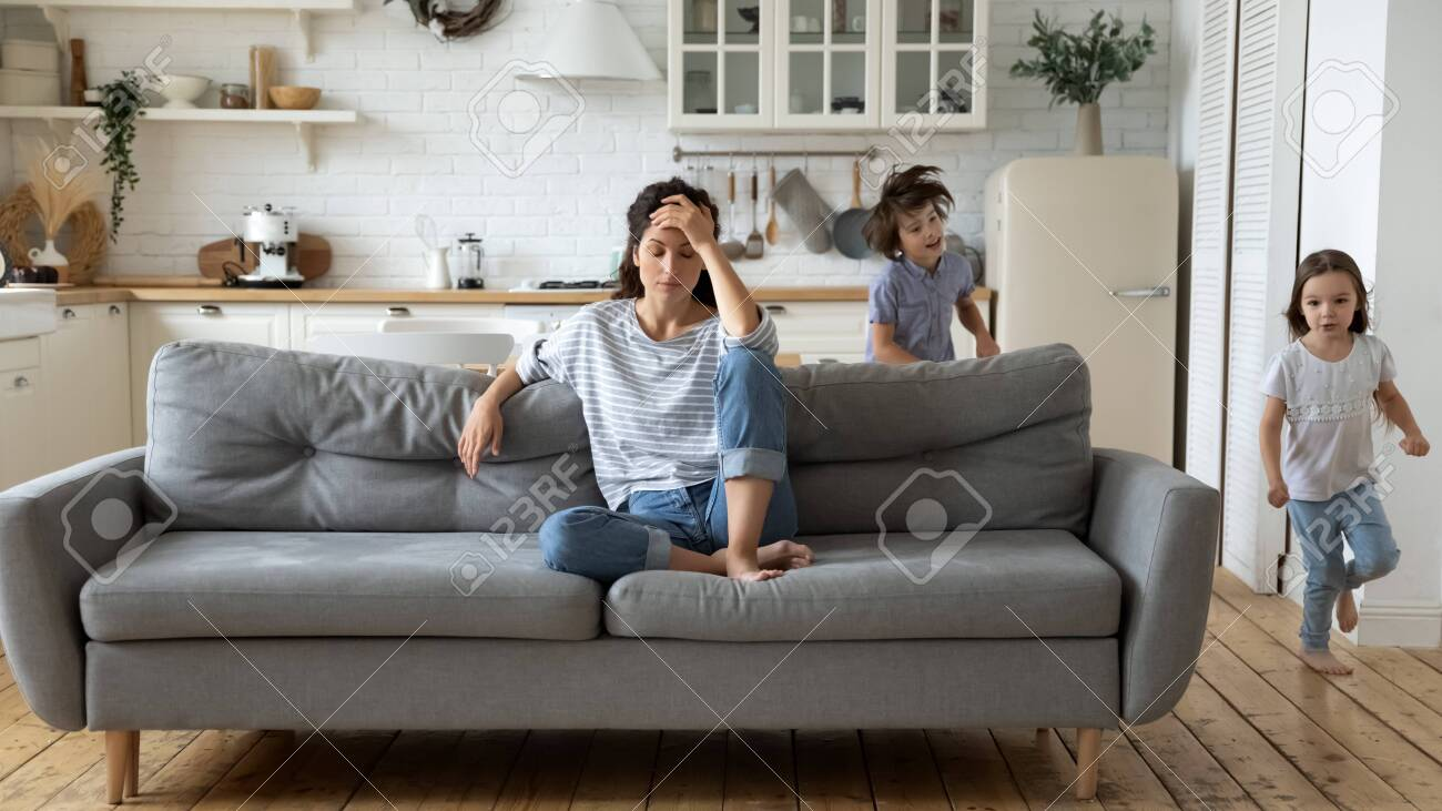 Exhausted Young Mum Sit On Couch In Kitchen Feel Unwell Tired Stock Photo Picture And Royalty Free Image Image 141265131