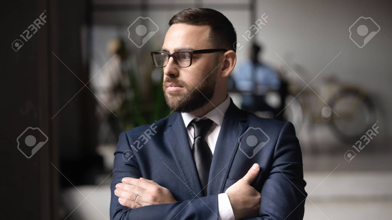 Serious Caucasian businessman in glasses look in distance thinking or visualizing, thoughtful middle-aged male boss lost in thoughts pondering over problem solution, plan, business vision concept - 145086302