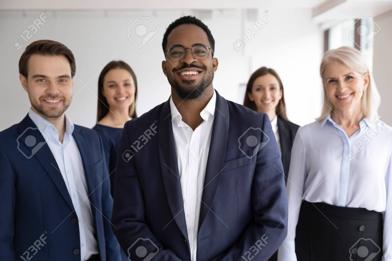 Diverse professionals bank employees company staff members in formal wear, 5 businesspeople lead by African ethnicity leader posing standing together in office. Young aged specialists portrait concept - 151917123