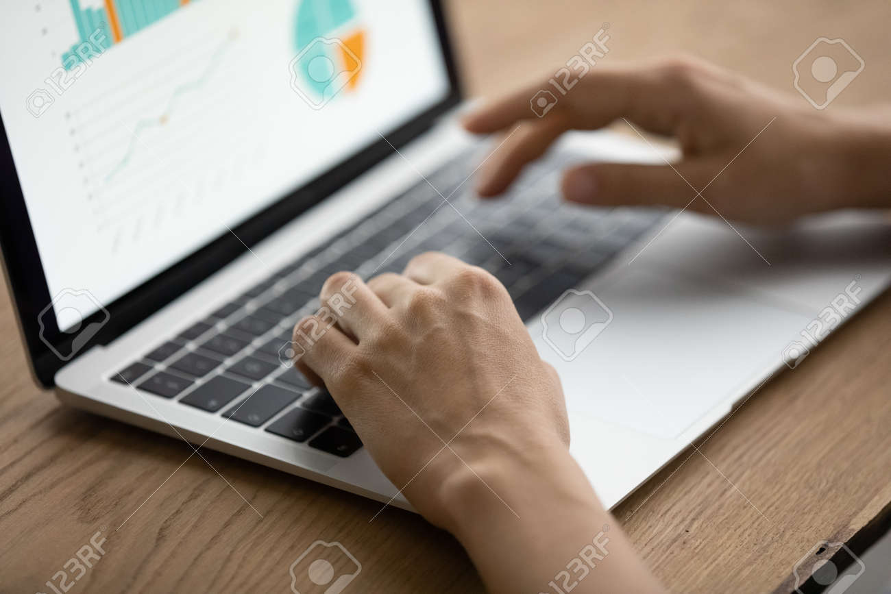Managing project performance. Close up of woman manager hands type on laptop keyboard prepare business analytic report via online service. Marketing specialist work with sales infographic on pc screen - 169015960