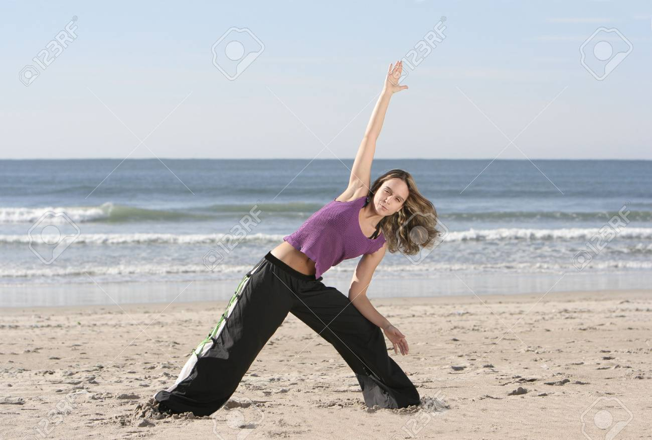 woman stretching at the beach Stock Photo - 2504403