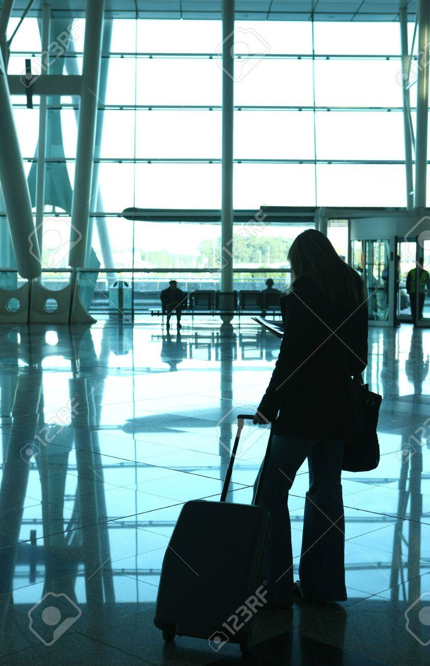 girl reading a magazine in the airport Stock Photo - 4772102