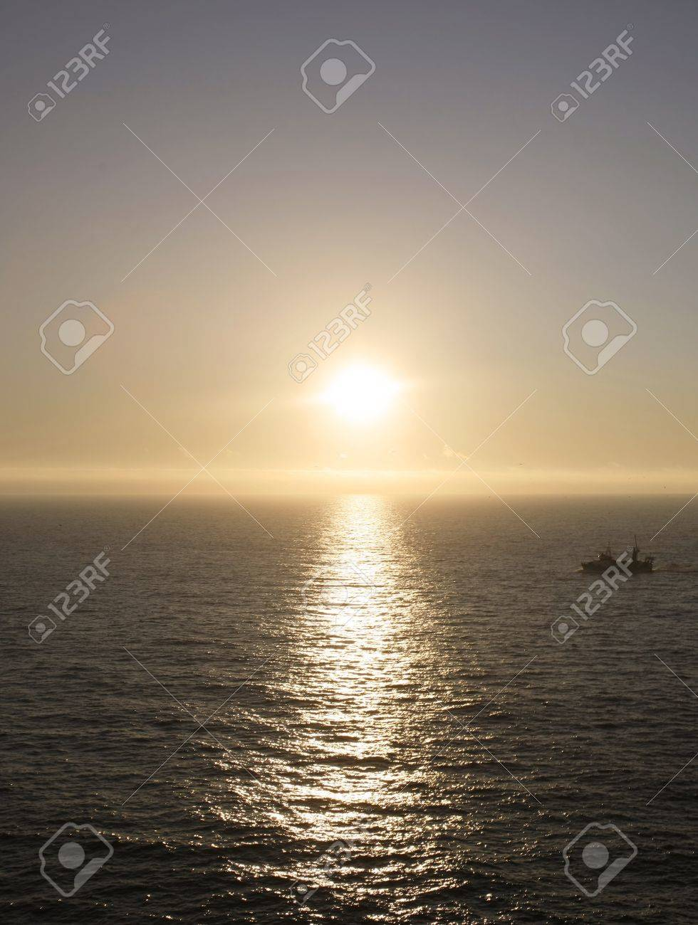 fishing boat with seagulls at sunset Stock Photo - 7140260