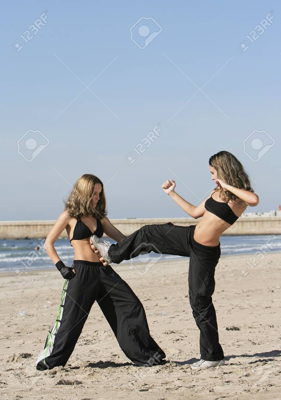 twins training in the beach Stock Photo - 7140248