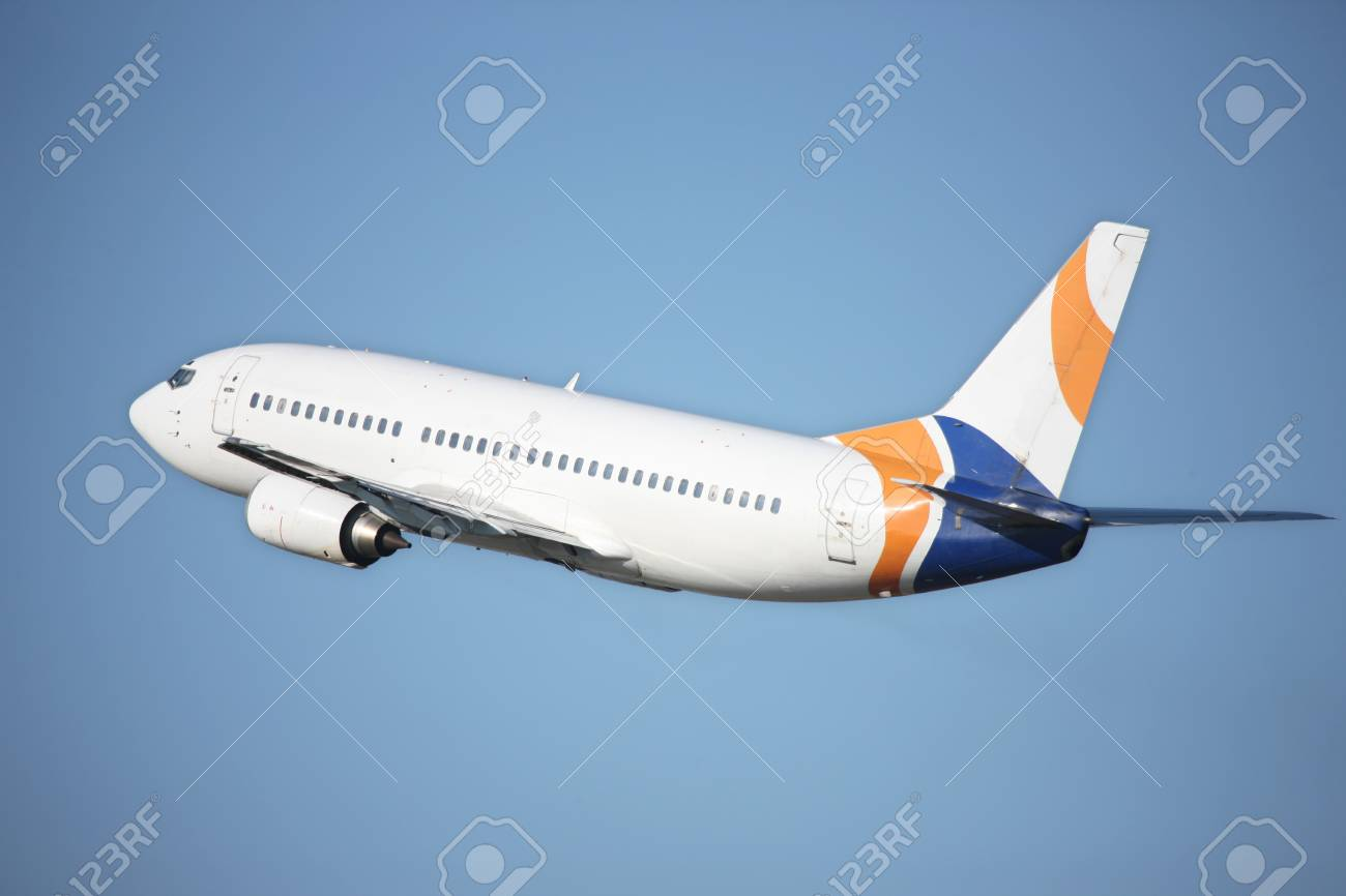 airplane flying against a blue sky Stock Photo - 7374012