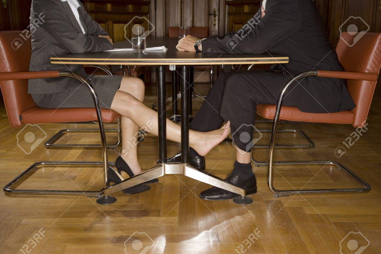 Businesspeople Playing Footsie Under Table Stock Photo Picture And