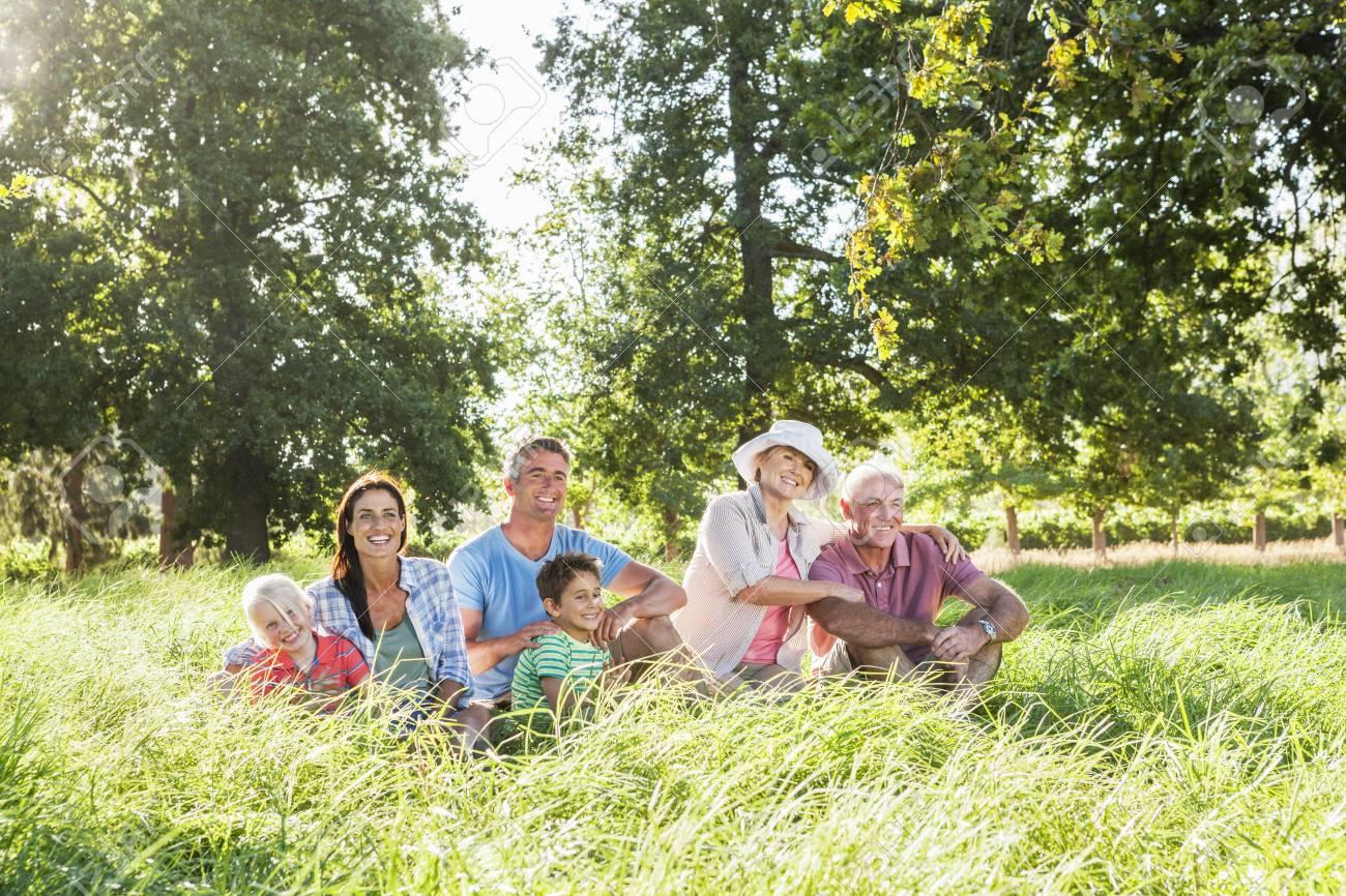 Multi-Generation Family Enjoying Walk In Beautiful Countryside Stock Photo - 28577567