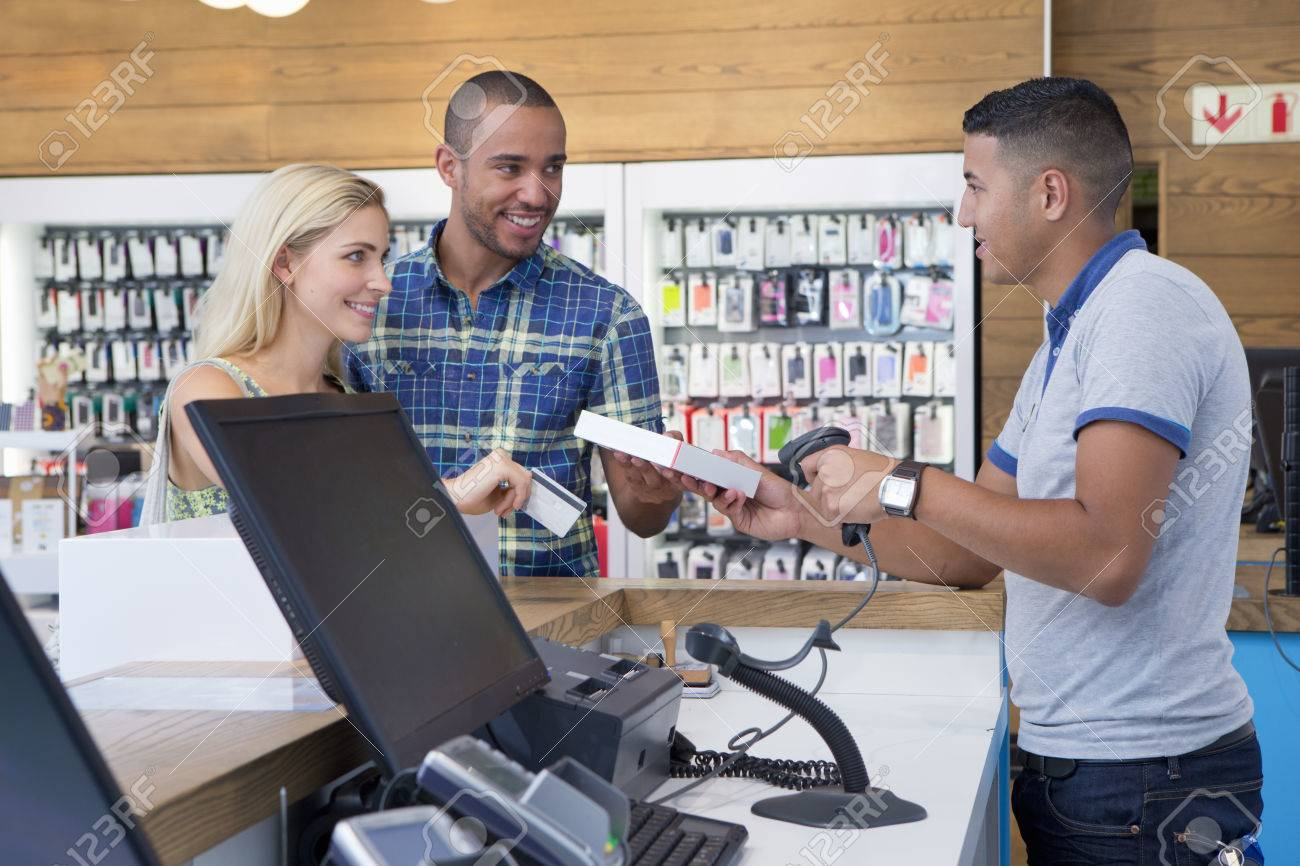 couple making a purchase from store assistant in phone shop stock couple making a purchase from store assistant in phone shop stock photo 38090365