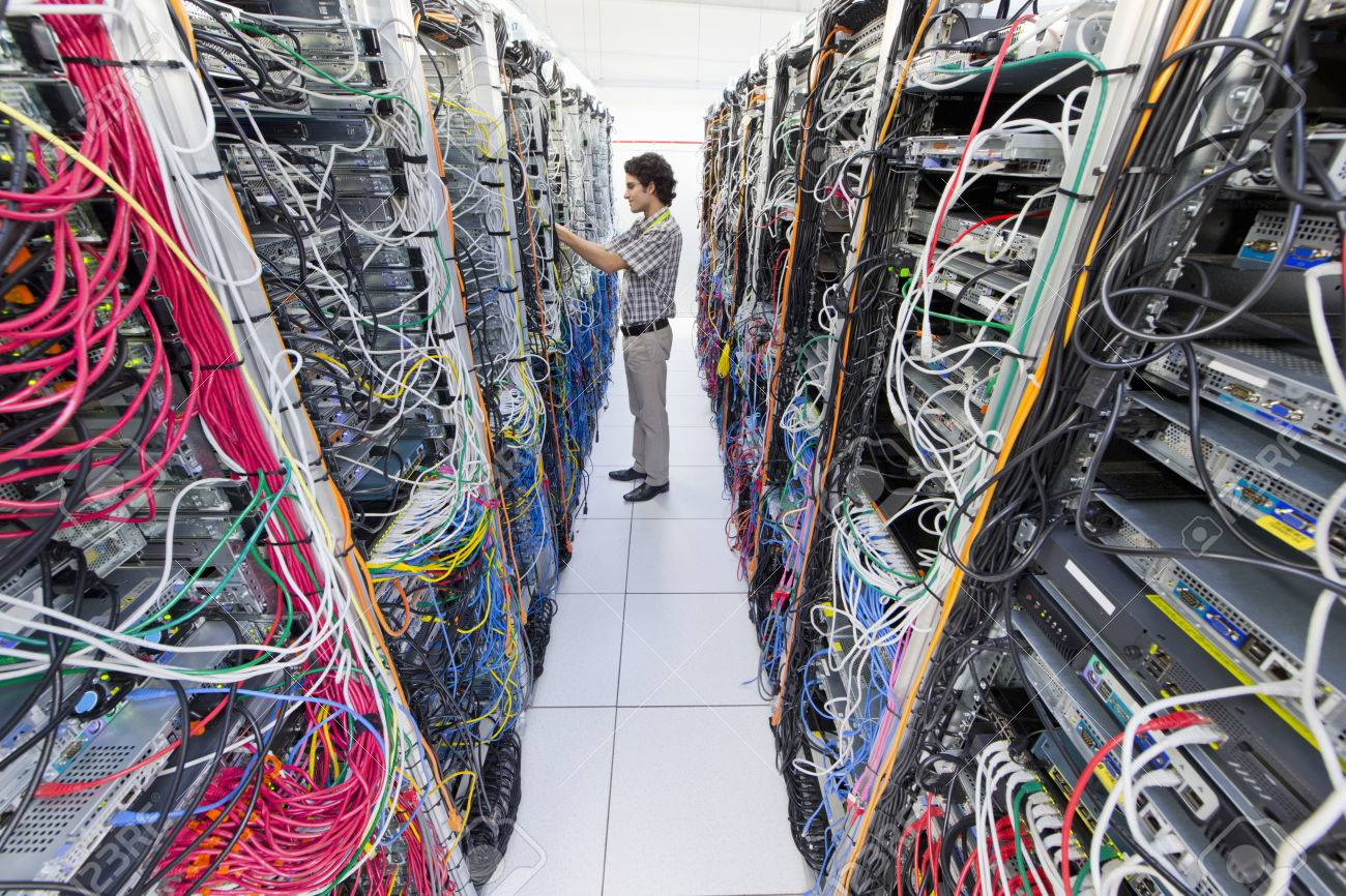 technician checking cables in server room of data center stock photo rh 123rf com Server Room Walls server room wiring best practices