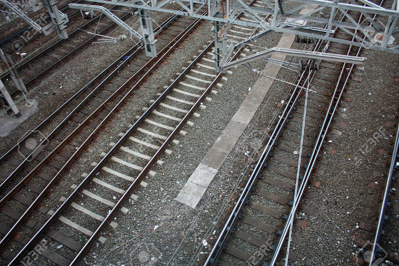 Railroad tracks and catenary, with crossings of roads and sidewalks. Bilbao, Spain. Stock Photo - 7162349