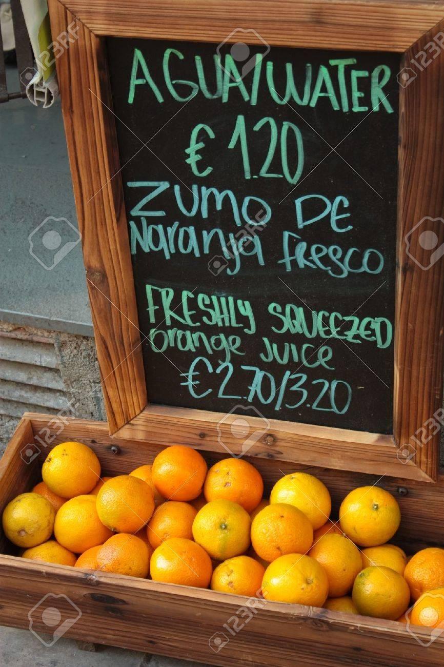stock photo trade orange juice in barcelona and blackboard