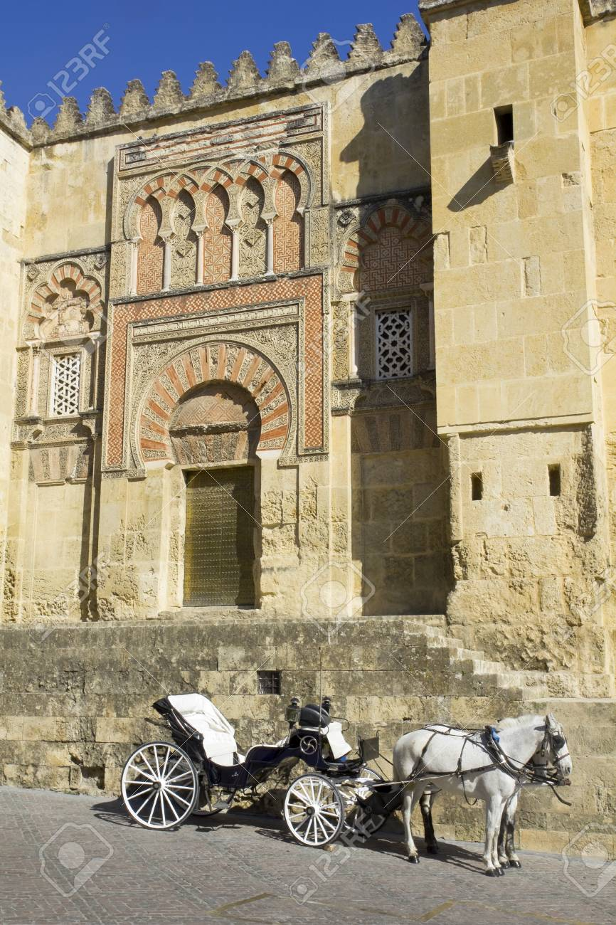 Horse carriage parked next to the mosque of Cordoba  Andalusia, Spain Stock Photo - 13157129