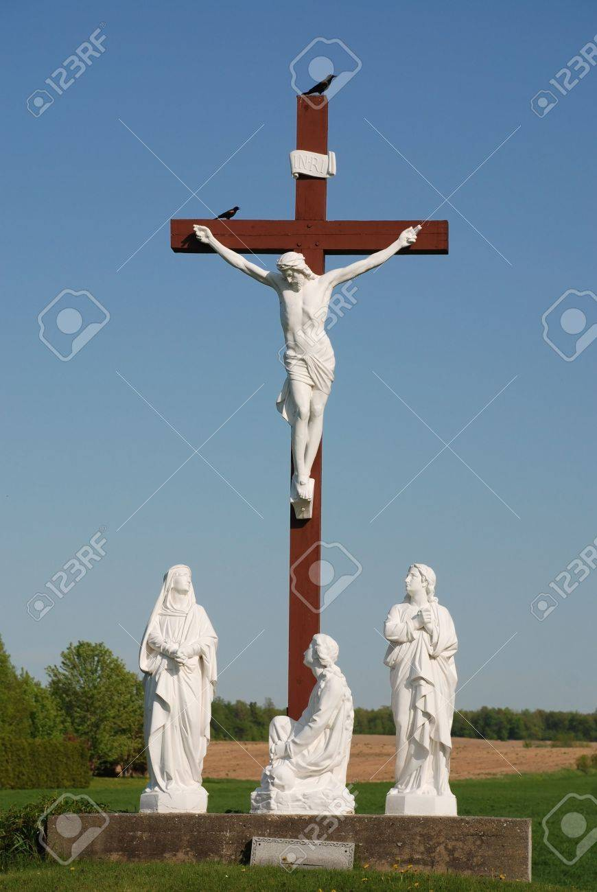 statue of redeemer jesus christ on wood cross stock photo picture