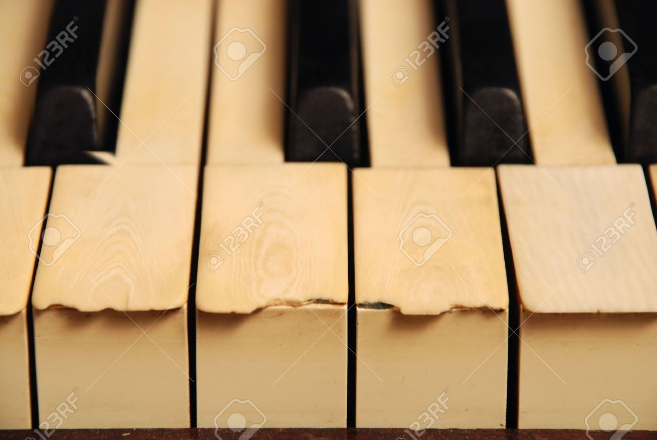 very old wooden piano with ivory keys broken and scratched Stock Photo - 5116619