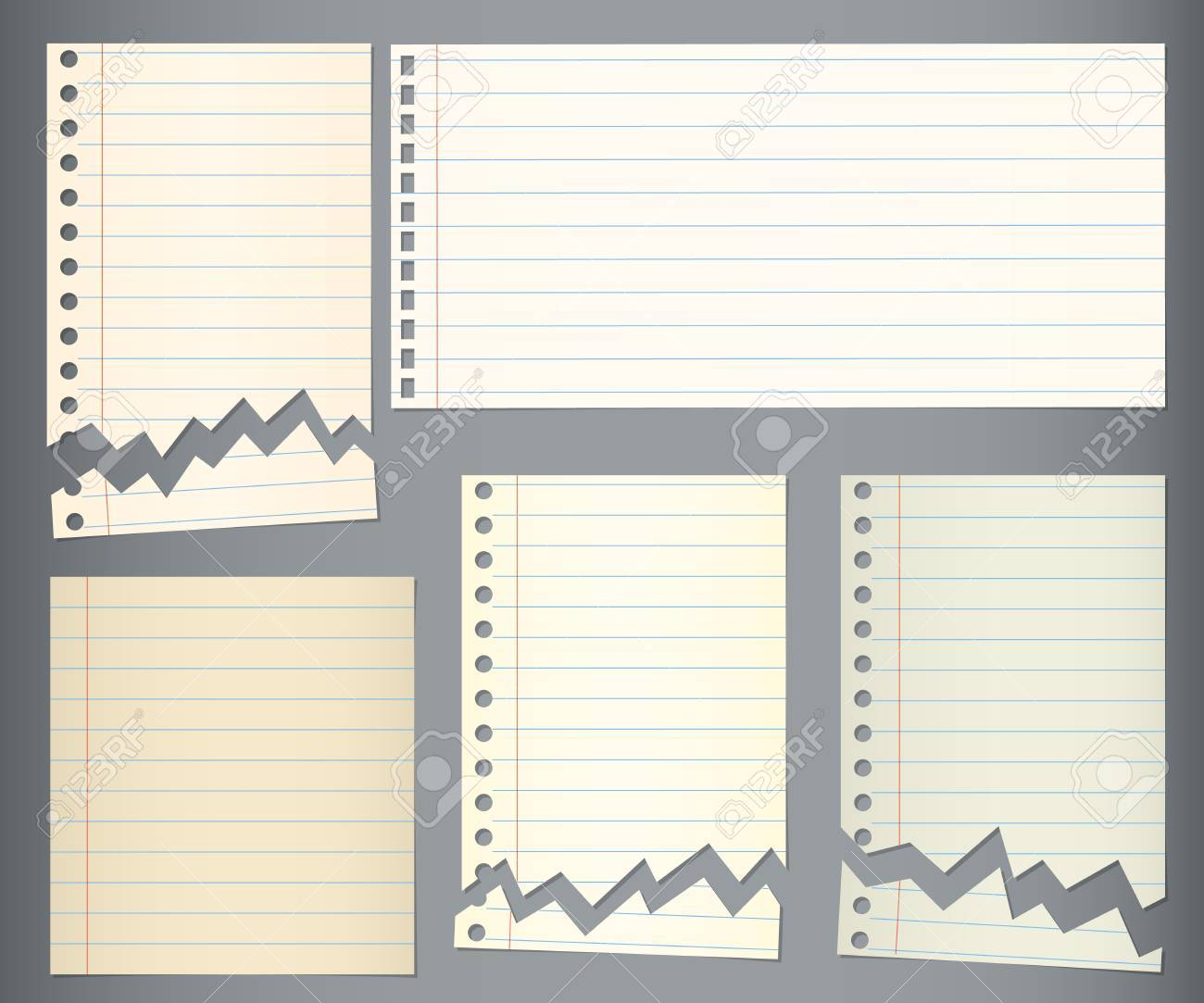 set of torn notebook paper with blue lines on dark background