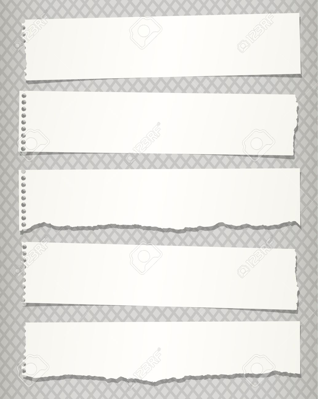 pieces of white torn notebook paper on gray background. royalty free