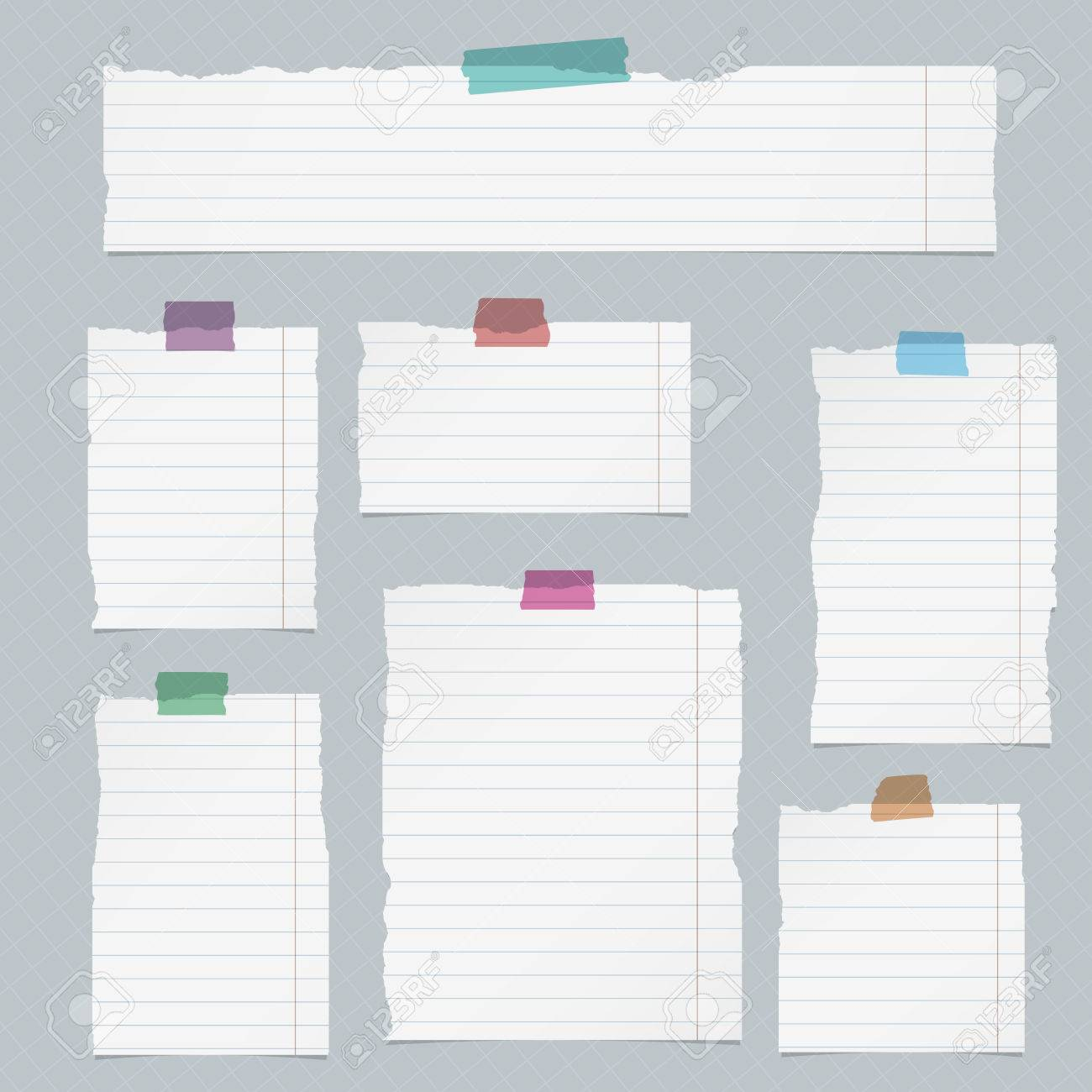 pieces of torn lined notebook paper on squared background. royalty
