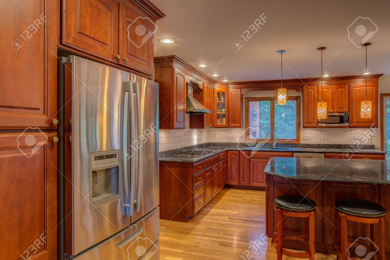 Cornor Newly Finished Kitchen With Granite Counter Top Hardwood Cabinet And  Floor Stainless Steel Fridge Stock