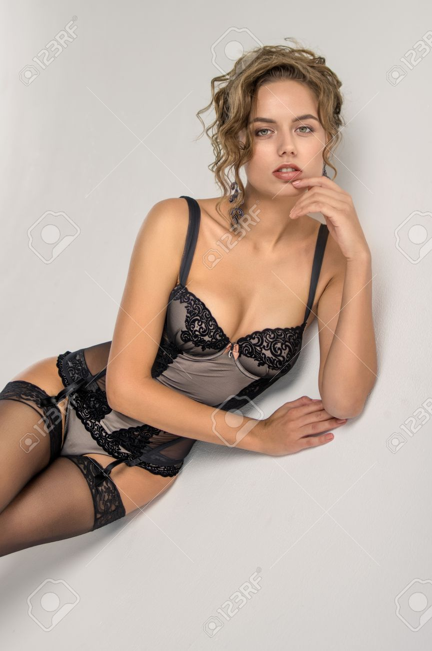 sexy woman in black lingerie on white background stock photo