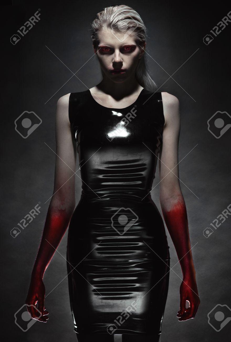 Black latex woman