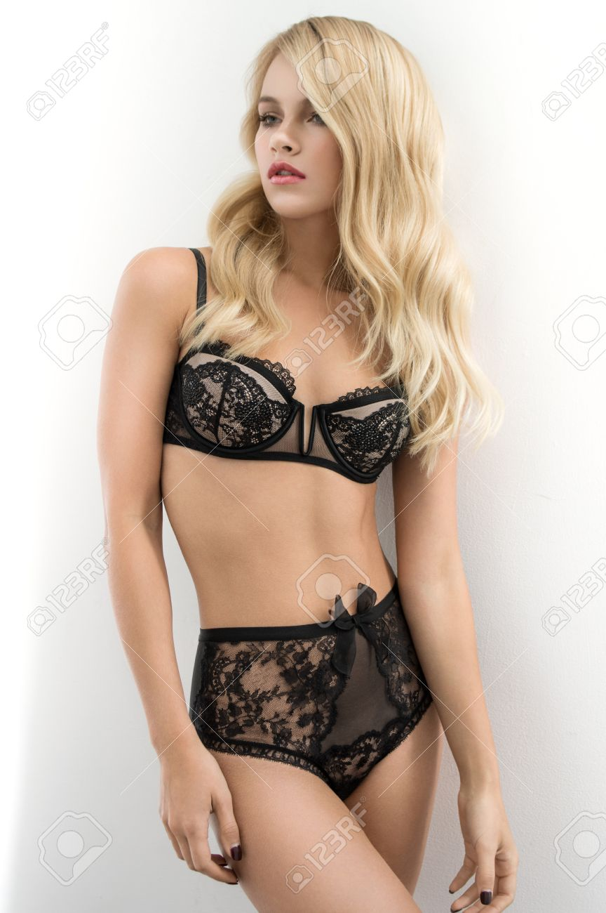 Blonde En Lingerie sexy blonde in dark lingerie stock photo, picture and royalty free