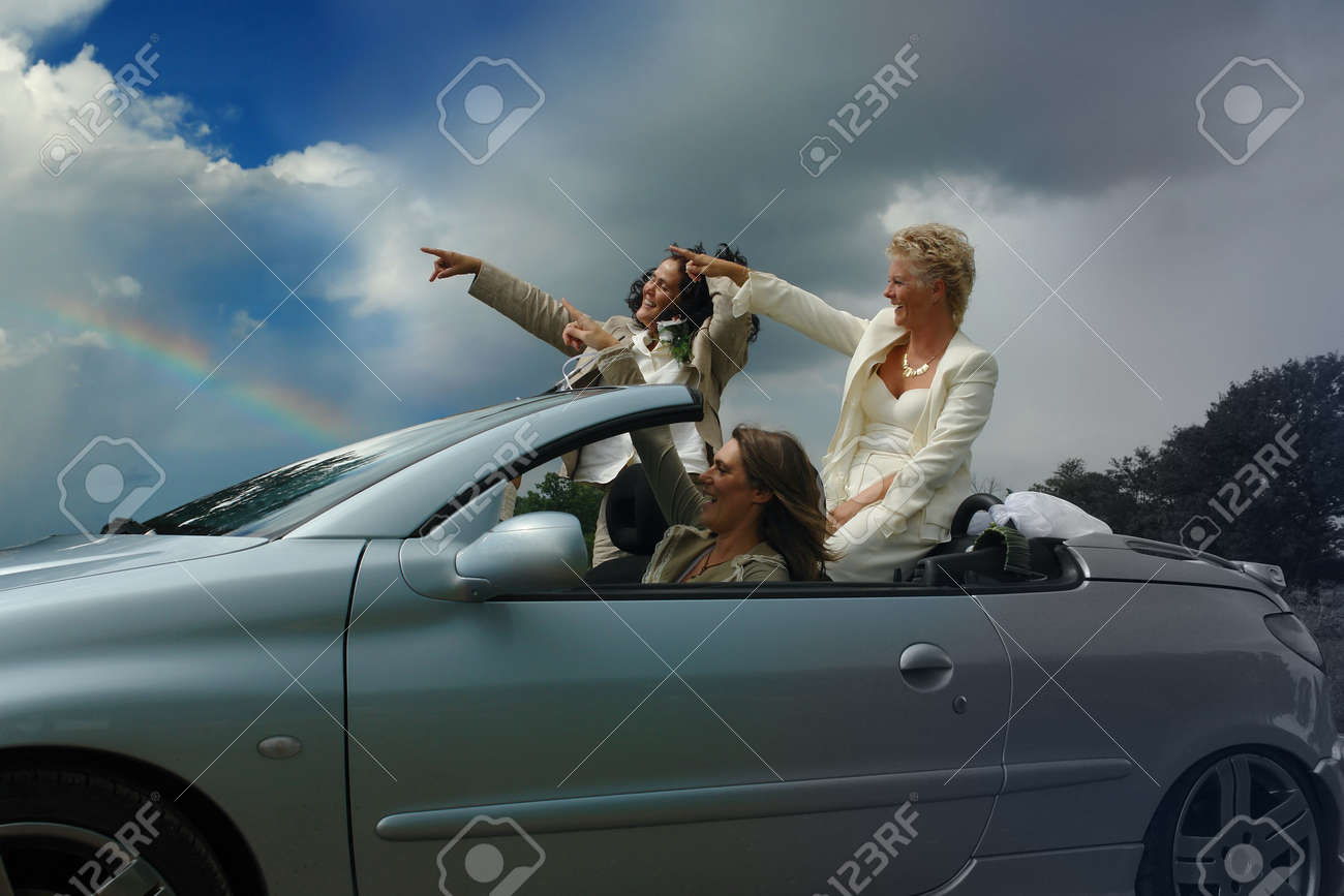 Mixed-age group of women pointing to a bright future in a convertible sports-car. Concept of liberation and escape from bigotry. Concept of feminism, and pride, and diversity. - 504275